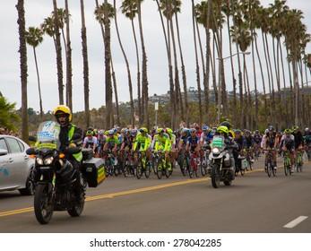 SANTA BARBARA, CA - May 14, 2015: Stage 5 of the Amgen Tour of California starts under palm trees and cloudy skies in Santa Barbara, CA.