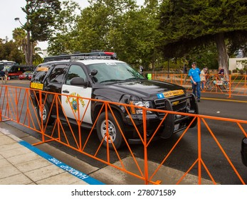 SANTA BARBARA, CA - May 14, 2015: The California Highway Patrol car at the end of the convoy waits at the curb before the start of stage 5 of the Amgen Tour of California bicycle race.