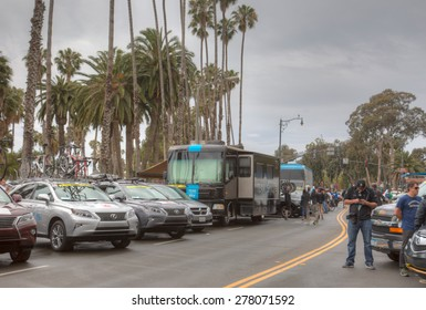 SANTA BARBARA, CA - May 14, 2015: Race team support vehicles and fans line near the start of stage 5 of the Amgen Tour of California before the race.
