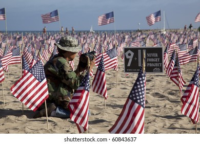SANTA BARBARA, CA - SEP. 11:  A photographer shoots 2977 U.S. Flags placed by Young America?s Fdn. and UCSB Republicans to remember those killed on 9/11/2001  Sep. 11, 2010 in Santa Barbara, CA