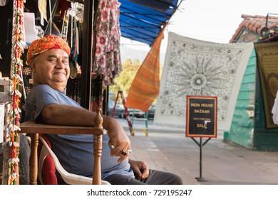 Santa Barbara, California, USA - September 19th, 2017: Portrait of an Indian seller sitting at his outdoors store, Santa Barbara.