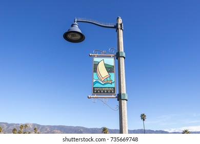 SANTA BARBARA, USA - DECEMBER 24, 2016. Pile with Santa Barbara Harbor sign near the harbor