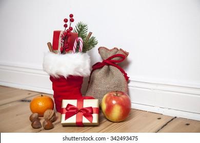 Santa Boots (St. Nikolaus) on wooden floor, vignette
