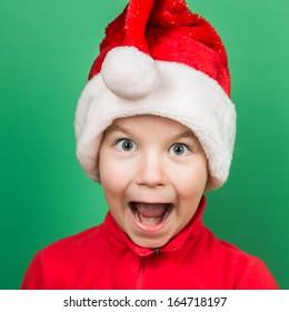 Santa boy playing on green background