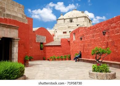 Santa Catalina white church with red wall & blue sky