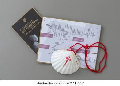 FLORIANÓPOLIS / Santa Catarina / Brazil - 03/11/2020: Symbols of the Camino de Santiago de Compostela, the scallop and the pilgrim's credential, essential document to stay in the hostels of the Camino