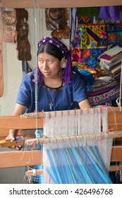 SANTA CATARINA PALOPO DE ATITLAN GUATEMALA NAY 01 2016:  Portrait of a Mayan woman weaving a tissus. The Mayan people still make up a majority of the population in Guatemala.