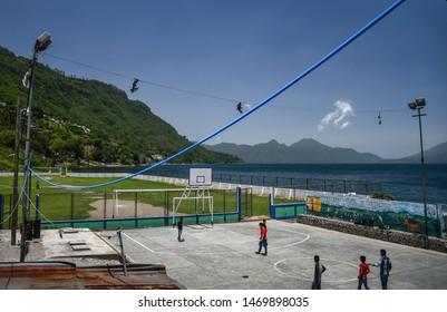 santa catarina palopo Guatemala 07/03/2019 latin children playing football/soccer at lake atitlan Guatemala
