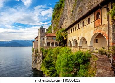 Santa Caterina del Sasso hermitage monastery is a popular landmark on Lago Maggiore Lake, Italy