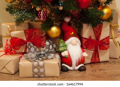 Santa with Christmas presents under the tree