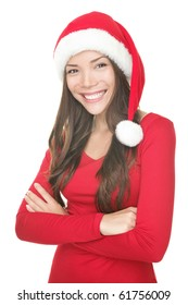 Santa christmas woman smiling portrait. Beautiful young woman in red wearing santa hat. Isolated on white background. Mixed asian / caucasian female model.