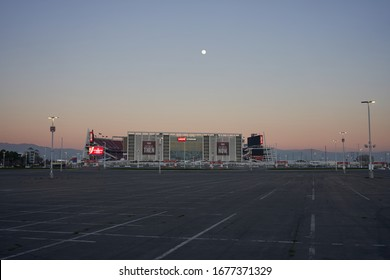 Santa Clara, CA, USA - Feb 7, 2020: The Levi's Stadium, home venue for the National Football League's San Francisco 49ers, viewed from the empty parking lot at dusk.