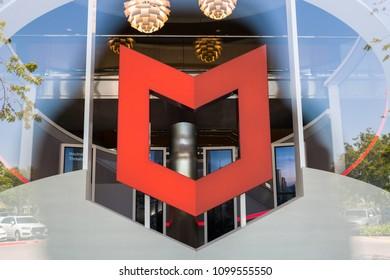 Santa Clara, California, USA - April 26, 2018: Signage with logo at the Silicon Valley headquarters of virus removal and cybersecurity company McAfee, Santa Clara, California.