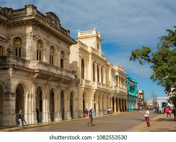 Santa Clara, Cuba - December 10, 2017: Palaces in the center of Santa Clara on a Sunday morning with the Cubans walking