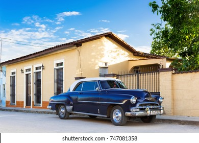 Santa Clara, Cuba - June 24, 2017: Black blue american Chevrolet vintage car with a white roof parked on the street in Santa Clara Cuba - Serie Cuba Reportage