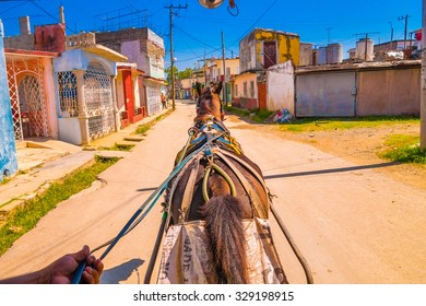 SANTA CLARA, CUBA - SEPTEMBER 08, 2015: Horse ride in Downtown in the capital city of the Cuban province of Villa Clara.
