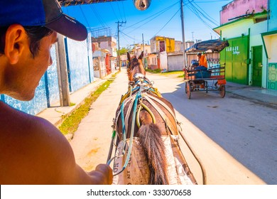 SANTA CLARA, CUBA - SEPTEMBER 08, 2015: Horse ride in Downtown in the capital city of the Cuban province of Villa Clara.