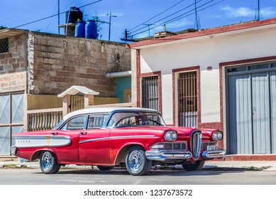 Santa Clara, Cuba - September 11, 2016: HDR - American red Ford Edsel Citation 1958 classic car with white roof parked on the side street in Santa Clara Cuba - Serie Cuba Reportage