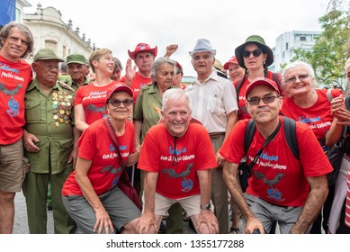 Santa Clara, Cuba-January 6,2019:   Members of the 'Southern Cross Brigade' (red t-shirts) from Australia mingle with Cuban veterans of the Revolution during the Victory Caravan event