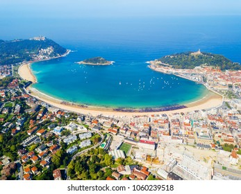 Santa Clara Island and San Sebastian Donostia city aerial panoramic view, Basque country in Spain
