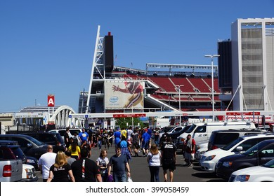 SANTA CLARA - MARCH 29: People walking through parking lot to arena before the  Wrestlemania 31, at the Levi's Stadium with Intel 49ers ad on side of building Santa Clara, California March 29, 2015.