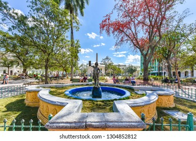 Santa Clara, Villa Clara, Cuba-January 25, 2019: 'Child with Boot' in the Leoncio Vidal Park which is a Cuban National Monument and a tourist attraction. The statue has become the symbol of the city