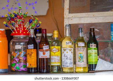 Santa Clara, Villa Clara, Cuba-January 30, 2019: Cuban Rum bottles displayed next to kid's candy. Alcohol in Cuba of easy access due to cheap prices.