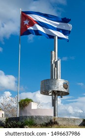 Santa Clara, Villa Clara, Cuba-July 15, 2019: Che Guevara monument in the 'Capiro' hill which is a National Monument and a tourist attraction. There is a large Cuban flag waving in the wind.