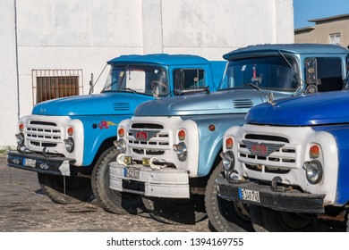 Santa Clara, Villa Clara, Cuba-May 5, 2019: Old vintage Russian Zyl trucks parked on a gas station.  The Caribbean island is known for having many obsolete vehicles still working