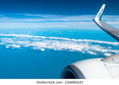 Santa Clara, Villa Clara, Cuba-October 3,2018: Westjet commercial plane flies in a vibrant blue sky with some clouds . WestJet Airlines Ltd. is a Canadian low cost airline company