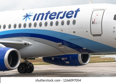 Santa Clara, Villa Clara, Cuba-October 3,2018: Close up to an Interjet commercial plane. The image shows the logo of the company in blue over the white body of the plane.