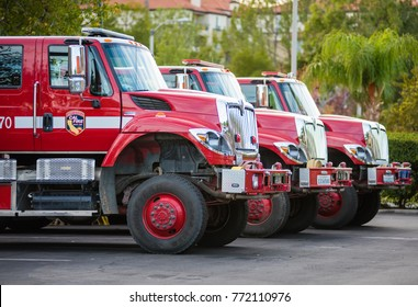 SANTA CLARITA, CA, USA - DECEMBER 8, 2017: Firetrucks are parked at a hotel where crews rest between fighting the nearby Southern California wildfires.