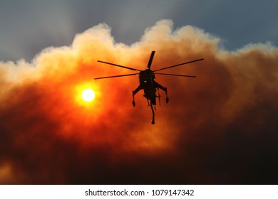 Santa Clarita, CA/USA - Oct 22, 2007: A firefighting helicopter pumps water from a golf course pond in Stevenson Ranch during the Magic Fire, to fight a blaze that erupted near housing.