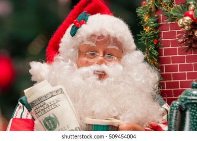 Santa Claus with 100 dollars on a background of christmas trees