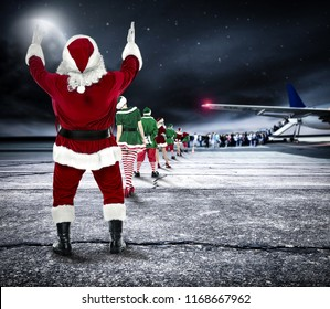 Santa Claus and airport background with plane.
