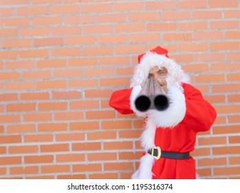 santa claus armed with shotgun