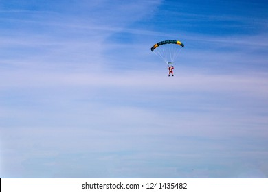 Santa Claus arrival by parachute. Santa Clause parachuting in the air. The concept of Christmas spirit. Copy space for your text