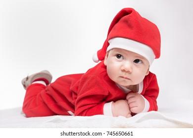 Santa claus baby girl lying on white blanket