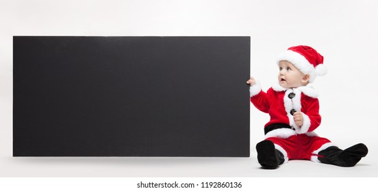 Santa Claus baby hold black advertisment banner blank