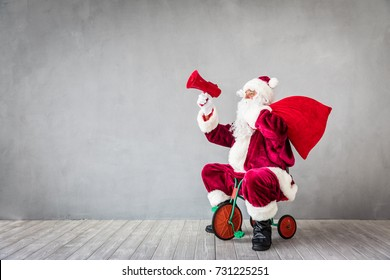 Santa Claus with bag riding bike. Christmas Xmas holiday concept