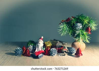 Santa Claus in a beautiful and humorous scene, with fallen sleigh, decorated pine branches, presents.