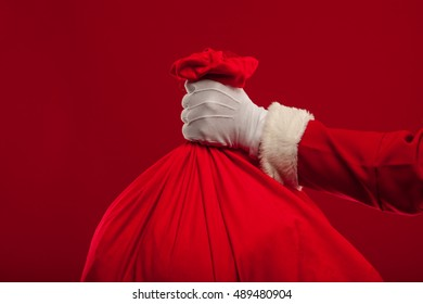 santa claus with big bag on red background
