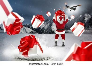 santa claus with big box and christmas gifts splash
