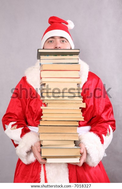 Santa Claus with a lot of books