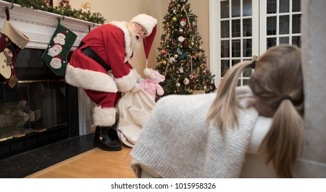 Santa Claus is caught on Christmas Eve by a child who waited up for him.