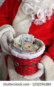 Santa Claus. Charity Money for the Poor. Donations for the Needy. Santa Collects Funds for the Homeless. Charity Contribution. Give money to causes. Red Cross Collections. Help the poor. Cash