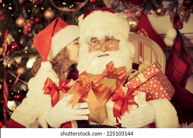 Santa Claus and child at home. Christmas gift. Family holiday concept