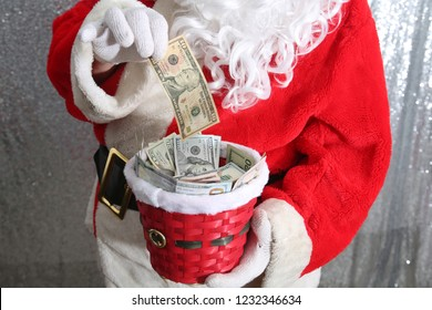 Santa Claus. Christmas Charity and Donations. Santa collects money for the needy or donations for the poor. Collection Plate.