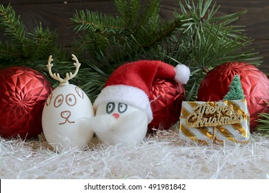 Santa Claus and Christmas deer on New year and Christmas .Unusual eggs with the faces ,muzzle.Christmas cartoon,  decorations.Eggs with faces on Christmas and new  2017 year.