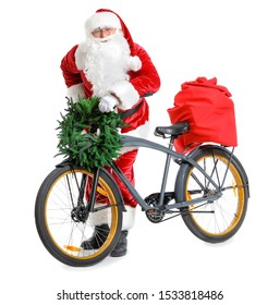 Santa Claus with Christmas gifts and bicycle on white background